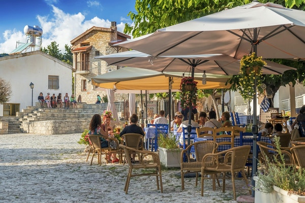 Omodos, Cyprus - October 4, 2015: Street cafe's with tourists in Omodos village, Limassol District.