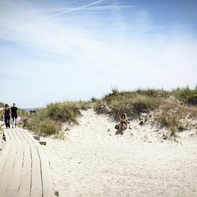 Mennesker på sanddyner